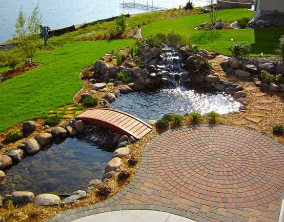 cobble stone pavers next to a small pond
