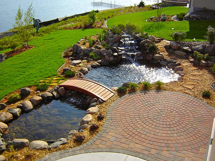 cobble stone pavers next to a small pond